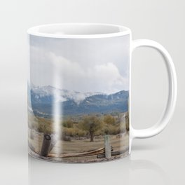 Fence and Mountains with Clouds Coffee Mug