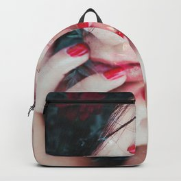 Face surrounded by flowers Backpack