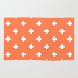 Swiss cross pattern on coral Rug