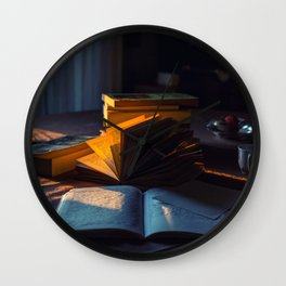 Sunset's light on books and notebooks Wall Clock