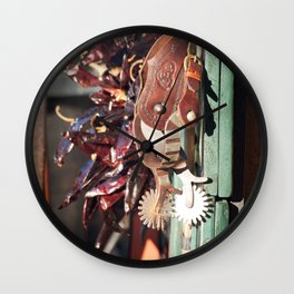 Cowboy spurs hanging with dried peppers Wall Clock
