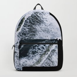 Waves crashing on a black sand beach – minimalist Landscape Photography Backpack