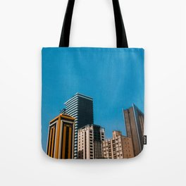 Buildings with blue sky Tote Bag