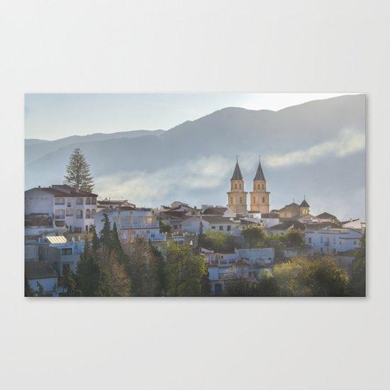 Twin spires of Orgiva town church Canvas Print