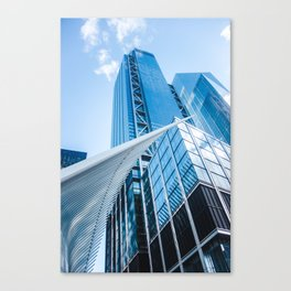 Westfield World Trade Center stretches over blue offices in the financial district of New York Canvas Print