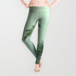 Tropical coconut palm trees on the ocean beach during sunset. Vintage stylized image. Leggings
