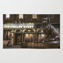Bobby Greyfriars dog statue at night Edinburgh Scotland pub Rug