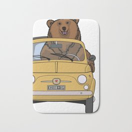 A brown bear riding a yellow convertible Bath Mat
