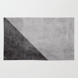 Concrete with black triangle Rug