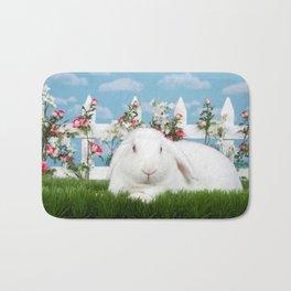 White lop eared bunny in a flower garden Bath Mat