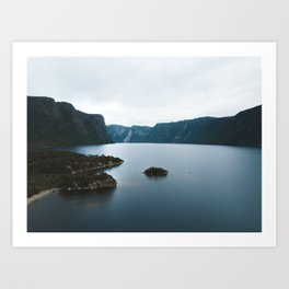 Overlooking cliffs on the edge of a lake Art Print