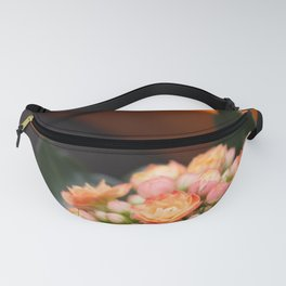 lady set with orange flower Fanny Pack