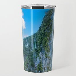 One of the numerous waterfalls falling down the sheer cliffs at Milford Sound. Travel Mug