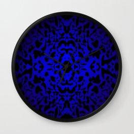 Openwork ornament of blue spots and velvet blots on black. Wall Clock