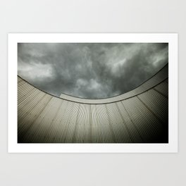 Building with metal covering against stormy sky Art Print