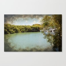 Secluded waterway with hidden boats Canvas Print
