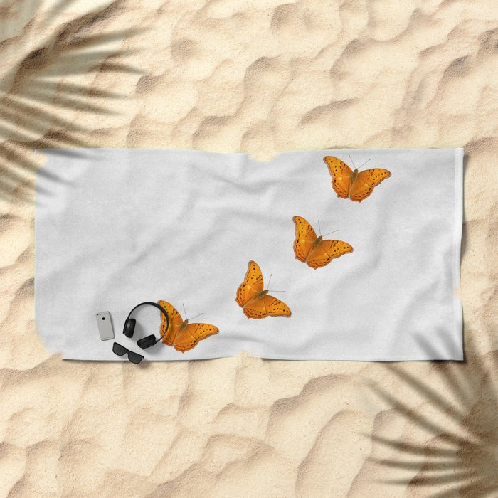 Beautiful butterflies on a textured white background Beach Towel