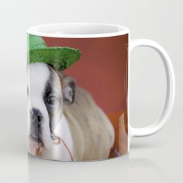 Christmas Bulldog Puppy Wearing a Green Hat Surrounded by Red Decorations Coffee Mug