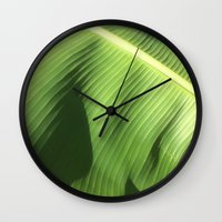banana leaf Wall Clocks featuring Banana Leaf by Glenn Designs