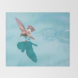 Storm petrel dancing on the ocean Throw Blanket