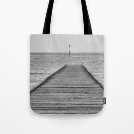 Dis a piering Tote Bag