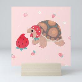Tortoises love strawberries Mini Art Print