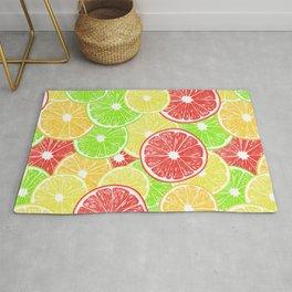 Lemon, orange, grapefruit and lime slices pattern design Rug