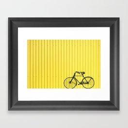 Vintage bike on yellow Framed Art Print