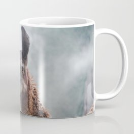 Curious, wise looking guanaco / llama on a misty morning in the Andes mountains, Peru Coffee Mug