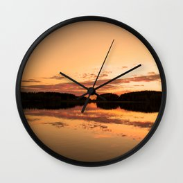 Beautiful sunset - glowing orange - forest silhouette and reflection Wall Clock