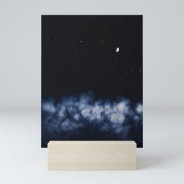 Contrail moon on a night sky Mini Art Print
