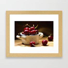 Red Cherries on the table Framed Art Print