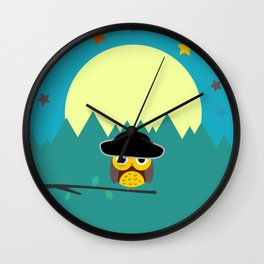 Clear night with a cute owl on a tree branch Wall Clock