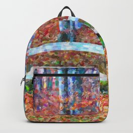 Wooden park bench in dry leaves Backpack