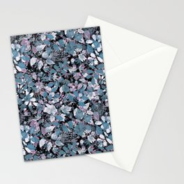 Openwork blue and purple leaves on a black background . Stationery Cards
