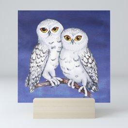 Two lovely snowy owls Mini Art Print