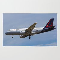 brussels Area & Throw Rugs featuring Brussels airlines Airbus A319 by David Pyatt