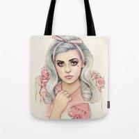 marina and the diamonds Tote Bags featuring L.O.V.E | E.V.O.L by Helen Green