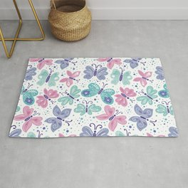 pink, teal and blue butterflies Rug