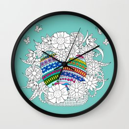 Easter ornamental eggs in the basket with flowers Wall Clock