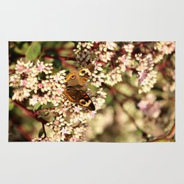 Buckeye Butterfly On Pale Pink Flowers Rug
