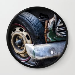 Flat tire on smashed vintage car Wall Clock