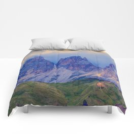 rocky mountain and cloudy sky Comforters