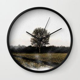 Solitary tree in the Ticino river natural park during winter before sunset Wall Clock