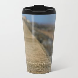 Along the wall Travel Mug