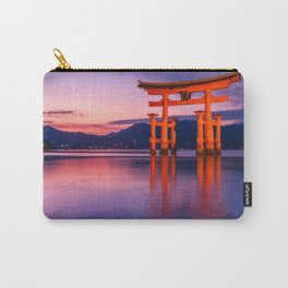 Wonderful sunset colors at the famous floating Torii Gate on Miyagima Island, Japan. Carry-All Pouch