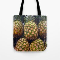 pineapples Tote Bags featuring Pineapples by UMe Images