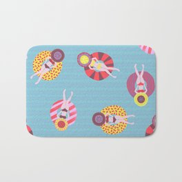 Floating in the Pool Pattern. Women on colorful floaties. Bath Mat