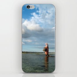 Lady catching mussels iPhone Skin