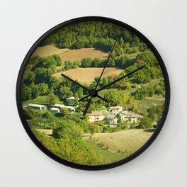 Italian mountain village in autumn landscape Wall Clock